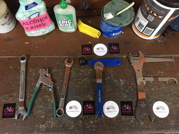 "Arial photograph of cleaning solutions and tools on a workbench, tools spelling out ""WTF"""